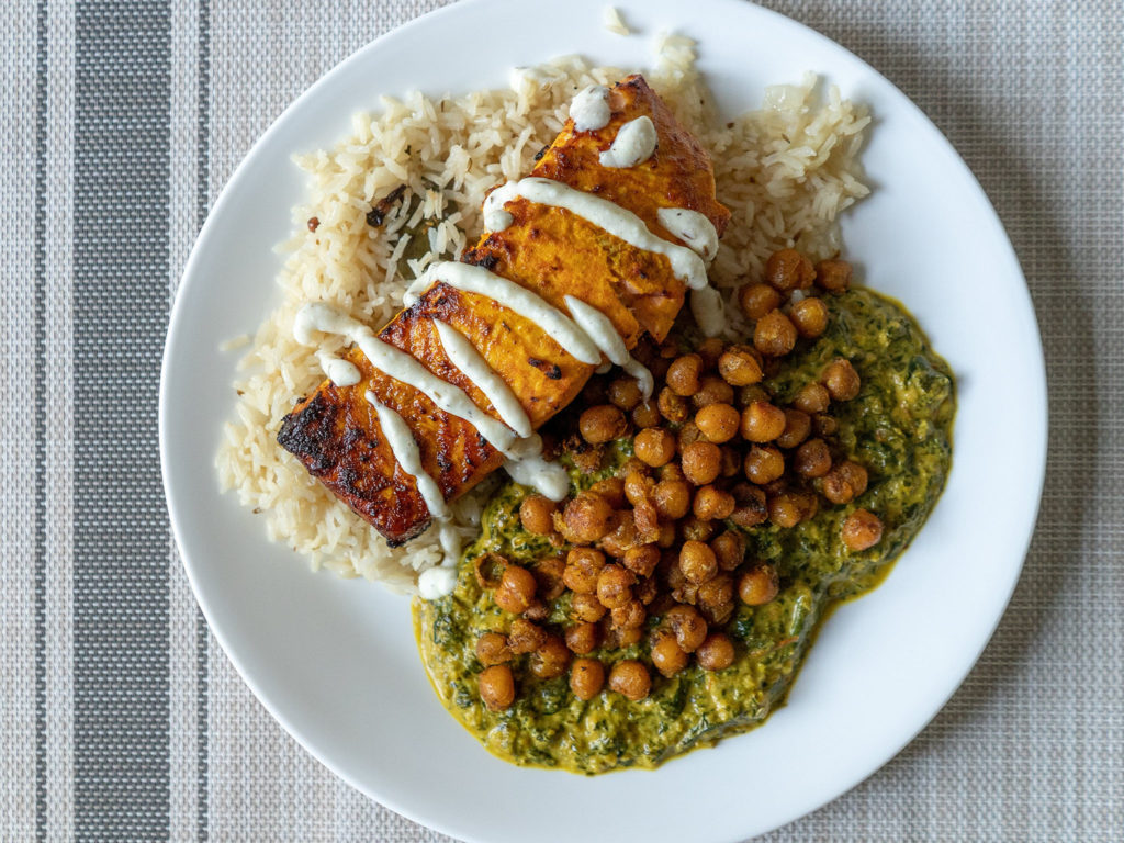 Air fried tandoori style salmon with rice, saag and chickpeas