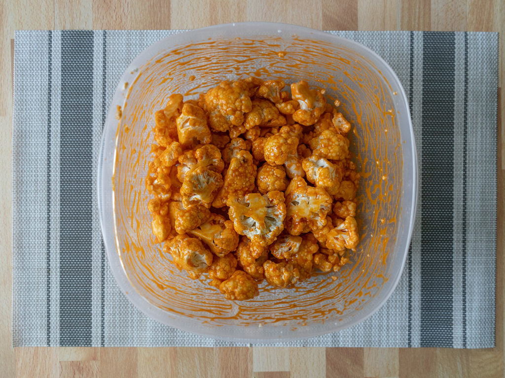 Buffalo cauliflower toassed in wing sauce