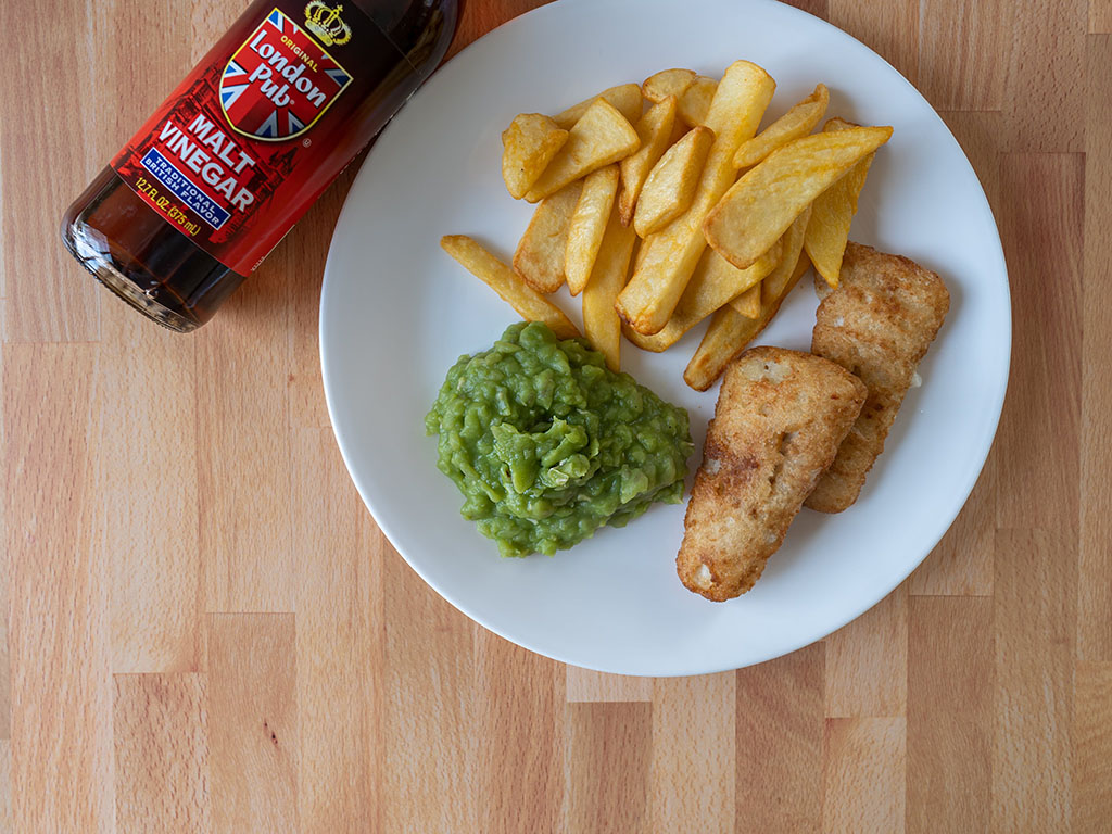 Mushy peas fish and chips and malt vinegar