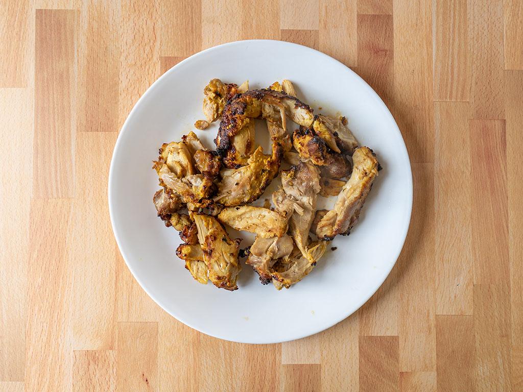 Air fried tandoori chicken thigh shredded