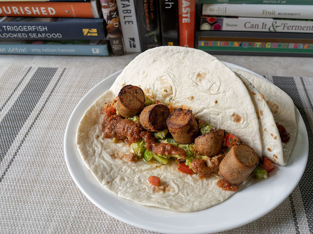 Air fried Field Roast sausage slices in taco